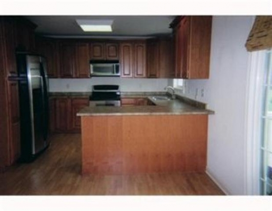 Beautiful Wood Cabinetry and Lovely Appliances